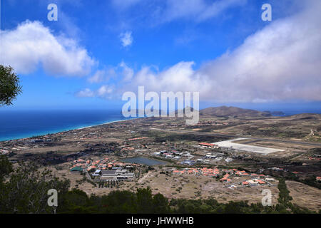 View of the beach and town of Vila Baleira and Ilheu da Cal seen from Pico do Castelo on the Portuguese Atlantic - Stock Photo