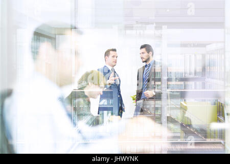 Business people in modern office. - Stock Photo