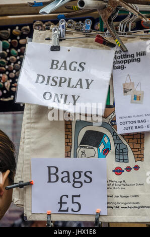 Bags for sale on a stall in Portobello Road Market. - Stock Photo