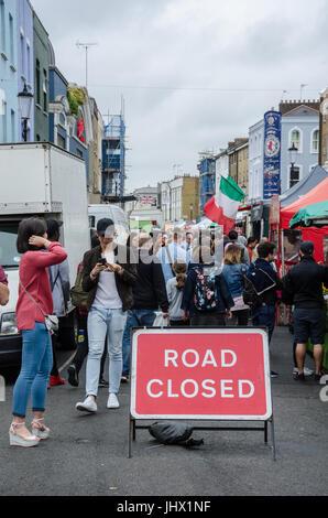 A busy scene on Portobello Road in Notting Hill, London. - Stock Photo
