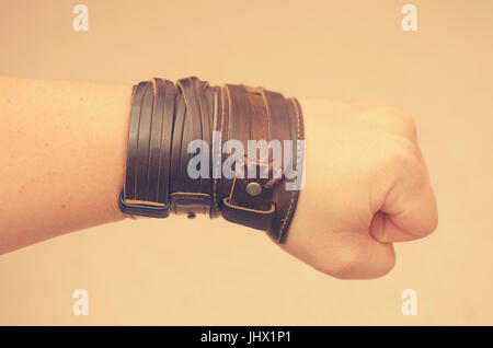 Modern fashionable leather and metal bracelets on the wrist - Stock Photo