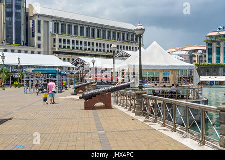 Port Louis, Mauritius - December 25, 2015: Caudon Waterfront at the harbour in Port Louis Mauritius with historical - Stock Photo