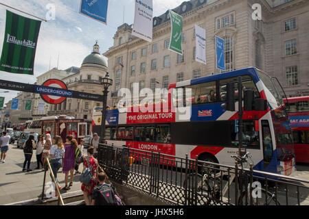A tour bus with The Original Tour latest branding of a Union jack flag drives through Piccadilly Circus Square, - Stock Photo