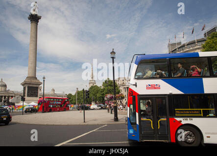 A tour bus with The Original Tour latest branding of a Union jack flag drives through Trafalgar Square on its route - Stock Photo