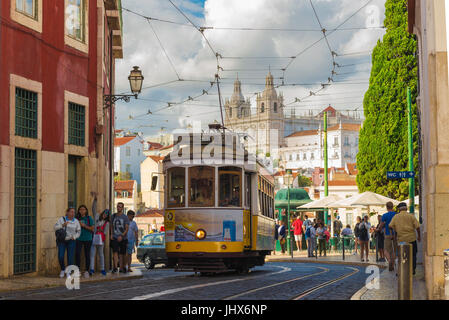 Lisbon tram, a no.12 tram leaves the Porta do Sol high up in the Alfama district and heads along the Largo Santa - Stock Photo