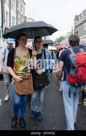 London, UK. 15th July, 2017. UK Weather: Grey clouds and passing showers in Portobello Road, London.  Matthew Ashmore/Alamy - Stock Photo
