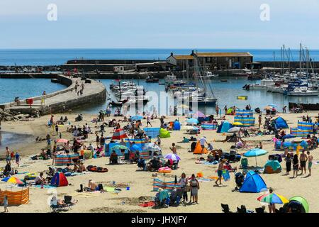 Lyme Regis, Dorset, UK. 17th July, 2017. UK Weather. Sunbathers on the beach enjoying the hot sunshine at the seaside - Stock Photo