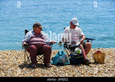 Lyme Regis, Dorset, UK. 17th July, 2017. UK Weather. Holidaymakers enjoying the hot sunshine on the beach at the - Stock Photo