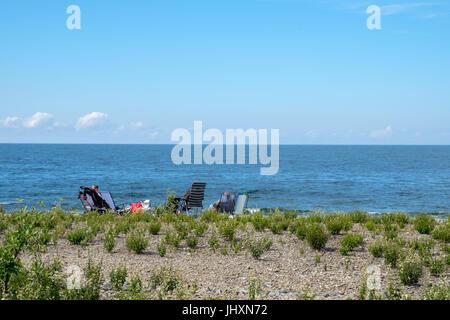 Tourists in loungers enjoy the seascape north of Byxelkrok. Byxelkrok is a popular tourist destination on Baltic - Stock Photo