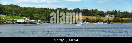 Panorama of the northern shore with a fishing pier and lobster trawlers moored in Pemaquid Harbor in Bristol, Maine, - Stock Photo