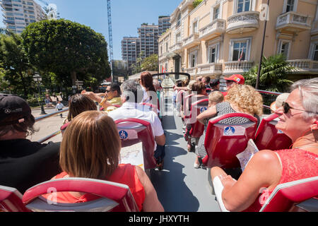Tourists on a guided tour with a Hop on Hop off bus, Monte Carlo, Monaco. - Stock Photo