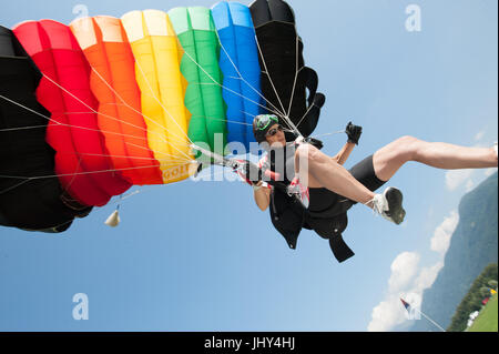 A skydiver practicing accuracy landing in Gordola, Switzerland - Stock Photo