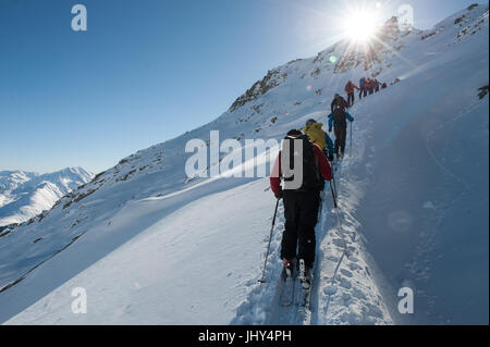 Sherpa from Nepal during a ski training camp in Disentis, Switzerland - Stock Photo