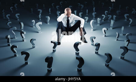 Businessman with many question marks. Concept of failure and problem - Stock Photo