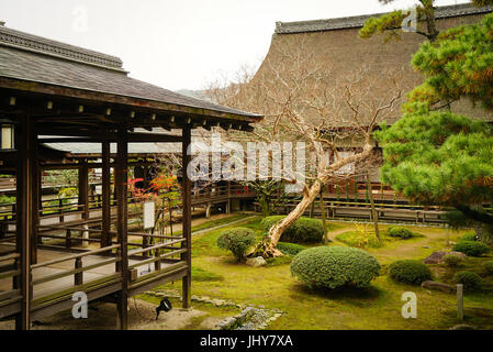Wooden halls of Shinto Shrine in Kyoto, Japan. Kyoto is famous for its numerous classical Buddhist temples, as well - Stock Photo