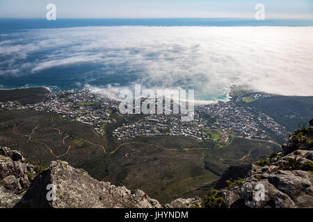 The view from Table Mountain over Camps Bay covered in low cloud, Cape Town, South Africa, Africa - Stock Photo