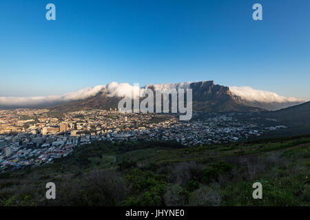Table Mountain covered in a tablecloth of orographic clouds, Cape Town, South Africa, Africa - Stock Photo