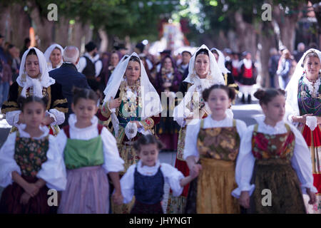Women and children in traditional dress during the Saint Antioco parade, Sant'Antioco, Sardinia, Italy, Europe - Stock Photo