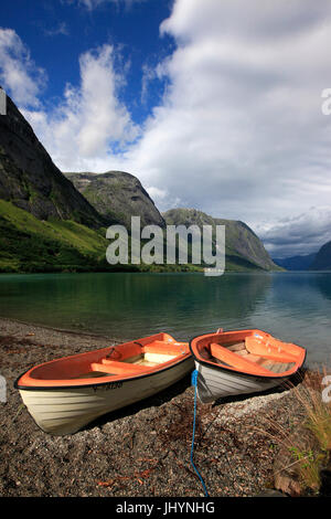 Boats pulled up on the shore of a fjord in the Fjordland region, western Norway, Scandinavia, Europe - Stock Photo