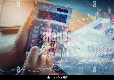 Double exposure technical finance and offshore oil and gas platform in night time background concept.hand man calculate - Stock Photo
