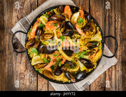 Traditional paella rustic Spanish - Stock Photo