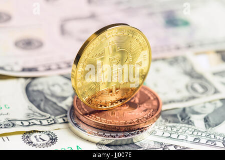 bitcoin coins on usa dollars close up - Stock Photo