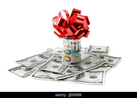 Dollars with red bow isolated on white - Stock Photo