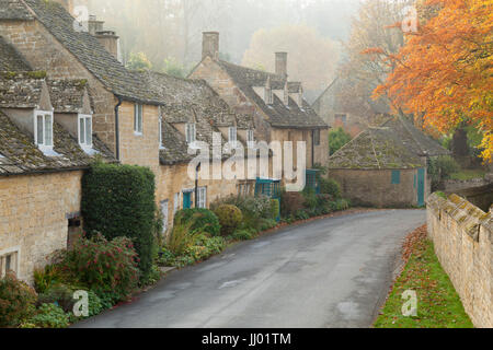 Line of Cotswold stone cottages in Autumn mist, Snowshill, Cotswolds, Gloucestershire, England, United Kingdom, - Stock Photo
