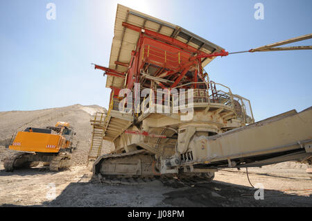 Stonecrusher and conveyor belt equipment in a chalk quarry. - Stock Photo