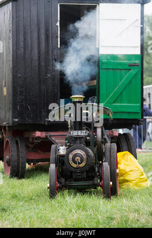 Vintage Miniature Steam traction engine at a country show. Working Scale model - Stock Photo