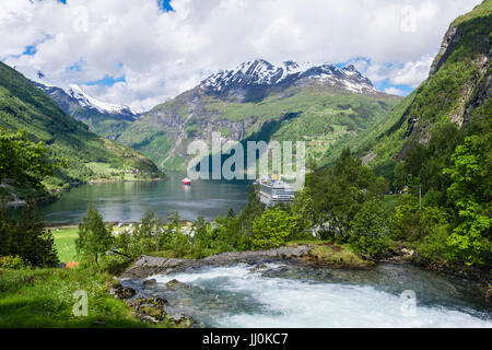 Scenic view above Geirangelva River to Geirangerfjorden with two cruise ships moored. Geiranger, Sunnmøre region, - Stock Photo