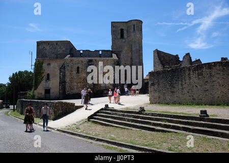 Oradour:  site of Nazi Massacre - crumbling buildings and rusting cars - left intact as it was on the order of General - Stock Photo