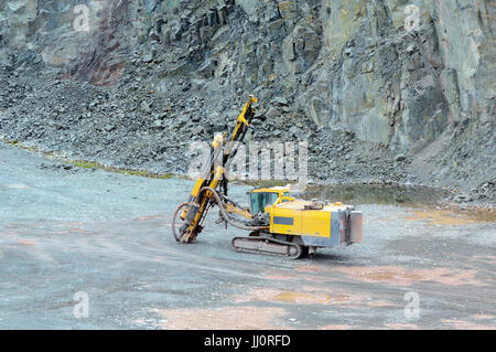 Driller in a quarry mine. mining industry. - Stock Photo