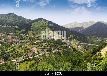 Aerial view of Metsovo tourist resort and  mountains at a summer sunny day, Epirus, Greece - Stock Photo