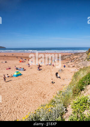 17 June 2017: Woolacombe, North Devon, England, UK - People enjoy the sunshine on one of the hottest days of the - Stock Photo