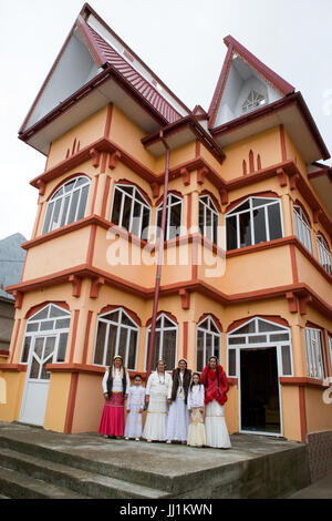 Women and girls of a Rom wealthy family in front of their luxury house, Ivanesti, Romania - Stock Photo