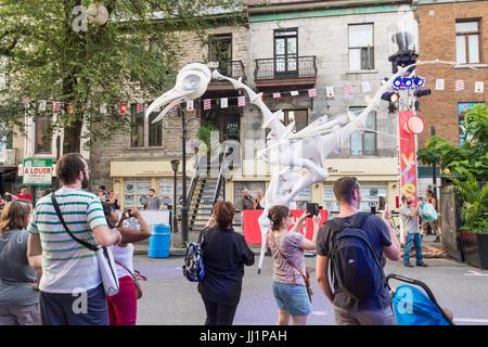 Montreal, Canada - 15 July 2017: 'Birdmen' on Saint Denis Street during Montreal Circus Arts Festival 2017 - Stock Photo