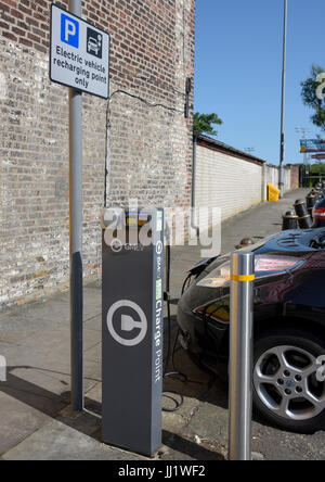 Electric car connected to gmev network electric car charging point with electric vehicle recharging point sign in - Stock Photo