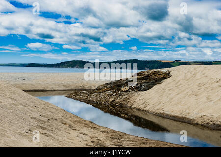 Carlyon Bay is a beach that formed from centuries of heavy Cornish industry, excess rock carried downstream ended - Stock Photo