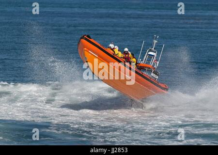 RNLI RIB lifeboat airborne in the sea at Speed - Stock Photo