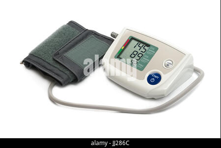 Blood pressure monitor (tonometer) on a white background. Translation of inscriptions on the panel: Upper pressure - Stock Photo