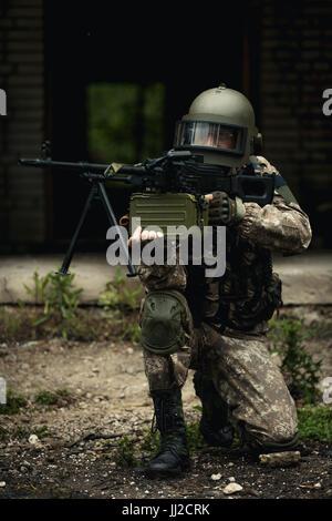 Striped player with submachine gun - Stock Photo