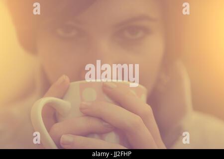 Woman with coffee / tea mug at autumn sunrise - Stock Photo