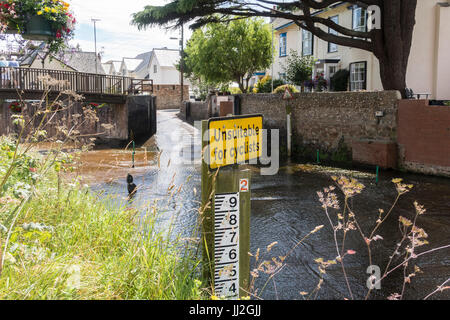 Sign saying 'unsuitable for cyclists' at the ford across the river Sid at Sidmouth, Devon. - Stock Photo