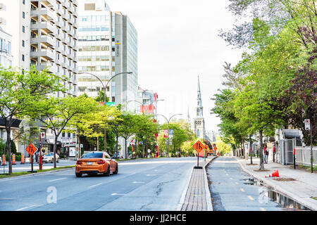 Montreal, Canada - May 27, 2017: Boulevard Rene-Levesque with separate bicycle lanes and view of Saint Peter and - Stock Photo