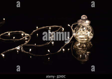 transparent spherical jar with fairylights - Stock Photo