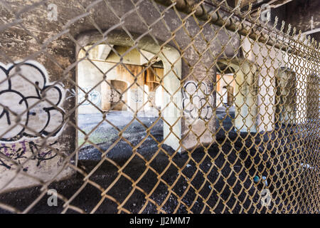 Montreal, Canada - May 28, 2017: Downtown abandoned underground area with graffiti and bridge during day outside - Stock Photo