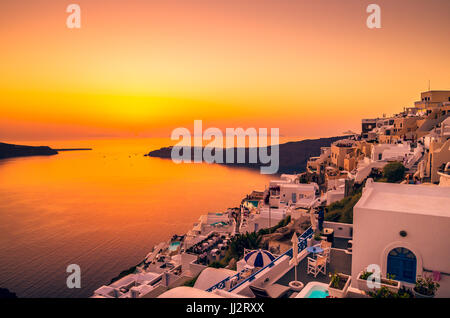 Santorini, Cyclades Islands, Greece. Sunset over Imerovigli near Thira town and Firostefani. - Stock Photo