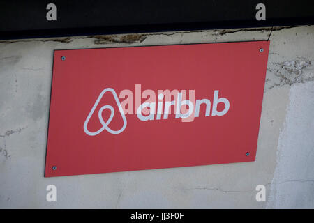 Picture of a parking space reservation sign with the logo of rental platform airbnb in Brunnenstrasse in the Mitte - Stock Photo