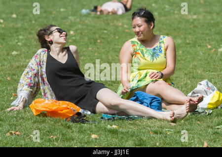 London, UK. 18th Jul, 2017. Two women enjoy the sunshine and warm weather in Victoria Gardens Credit: amer ghazzal/Alamy - Stock Photo